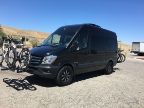 Lynda's Sprinter Van. 5 peeps and 8 bikes.